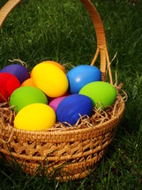 multicolored eggs in a basket