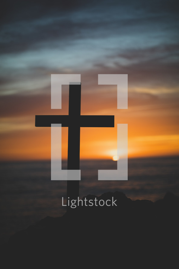 silhouette of a cross at sunset