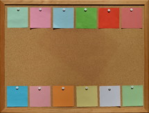 blank sticky notes pinned to a cork board