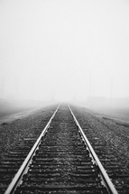 fog over railroad tracks