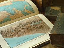 old books with maps of Israel,