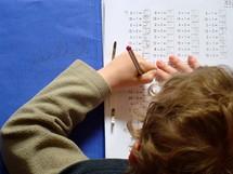 pupil doing homework pupil, school, schoolchild, child, homework, student, schoolkid, school kid, school child, school supplies, prep, home work, preparations, learn, learning, teach, teaching, kid, maths, math, mathematics, boy, young, children, hand, hands, pencil, write, writing, wrtitten, home, sit, sitting, parents, parenting, youth, study