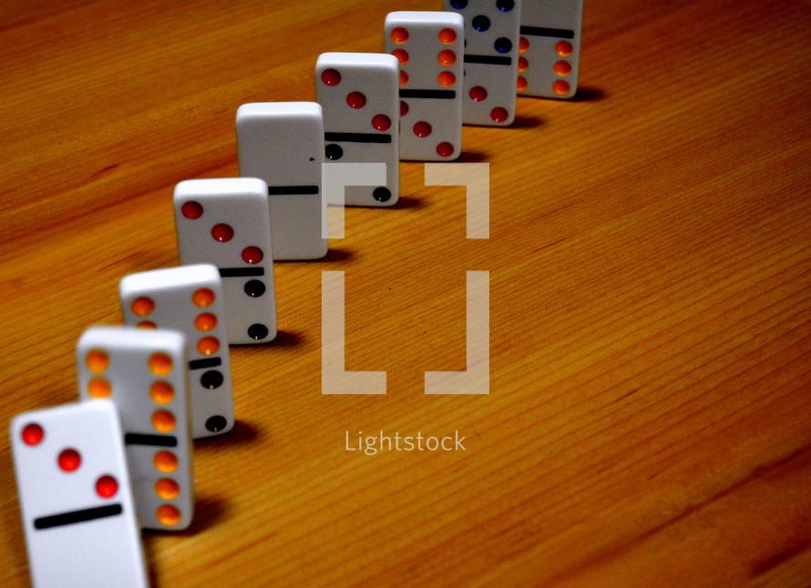 dominoes on a wood floor