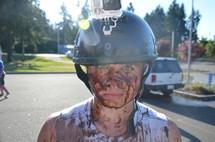 helmet cam and a muddy boy