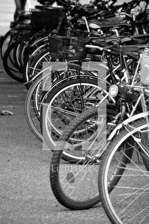 lots of bicycles,  bicycle, bike, bikes, bicycles, cycle, cycles, ride, riding, mobile, sport, sports, outdoor, lot, many, plenty, much, mobility, acitve, actively, action, move, engage, travel, along, park, parked, parking, layby, monochrome, black, white, grey, biking