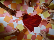 sticky notes in the shape of a heart