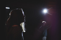 worship leaders on stage under spotlights