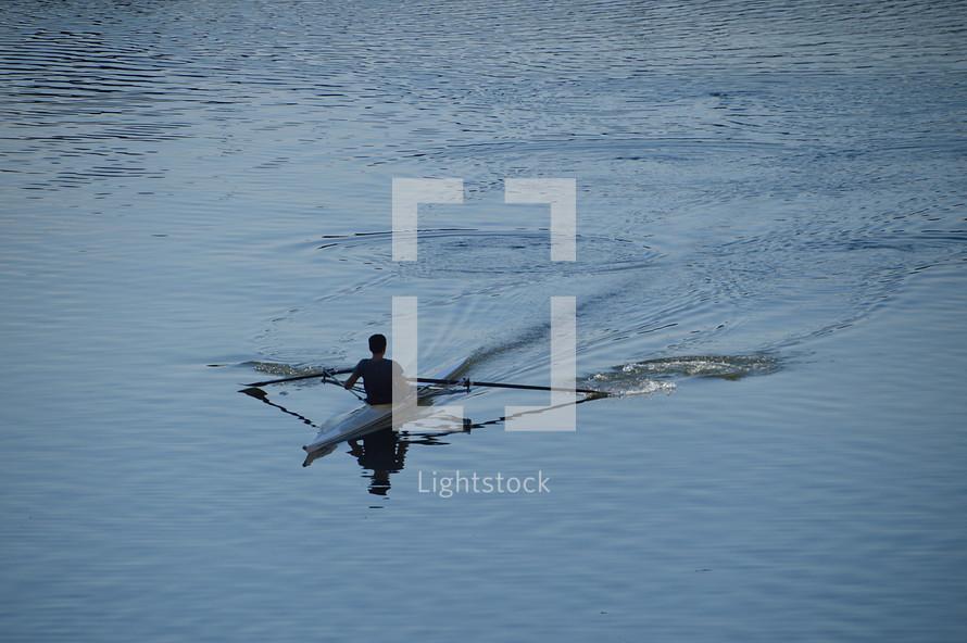 canoe in blue water.