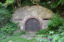 a cellar or refuge hidden in a hillside