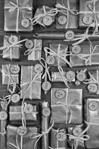 Advent calendar with twenty four silver presents on grey wood