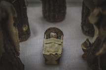 baby Jesus figurines in a Nativity scene