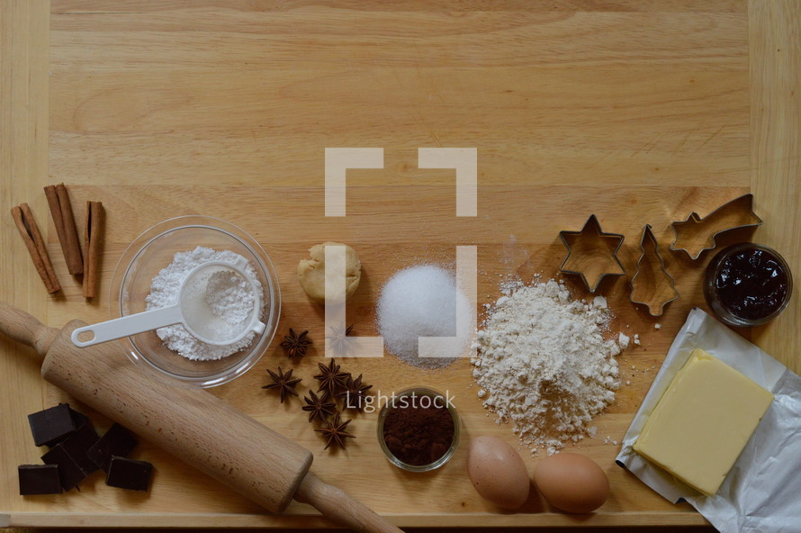 Border of baking ingredients for christmas cookies with copy space above