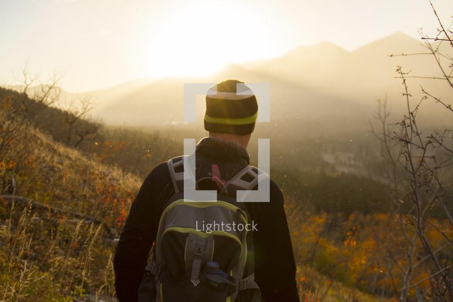 a man hiking under bright sunlight
