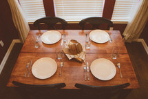 A dining table set for a meal.