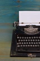 vintage typewriter on teal wooden desk