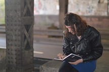 a woman writing in a journal