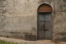 Old wooden doorway with double doors