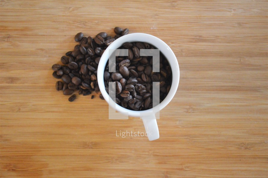 overhead coffee mug filled with coffee beans