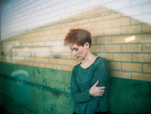 model, woman, looking down, sad, redhead, outdoors, posing, short hair
