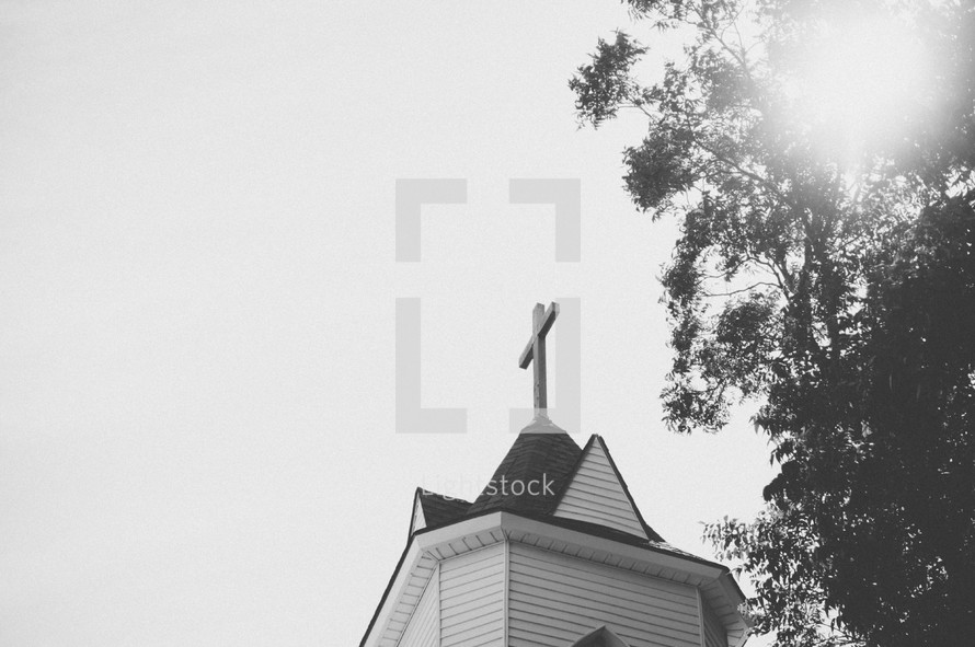 cross topper on a church steeple