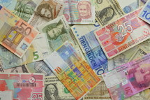 pile of currency from various countries