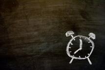 alarm clock in chalk