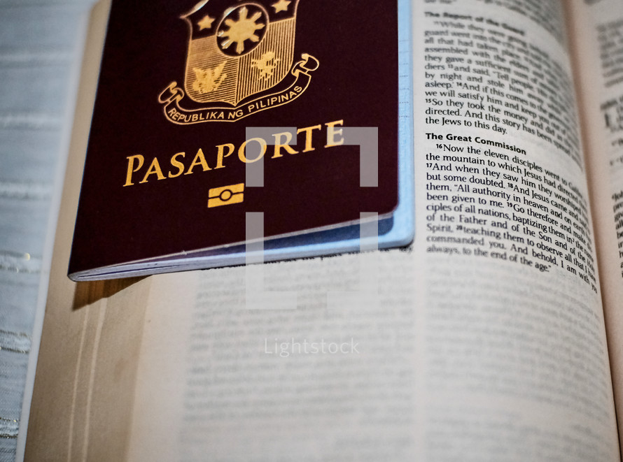 passport on an opened Bible