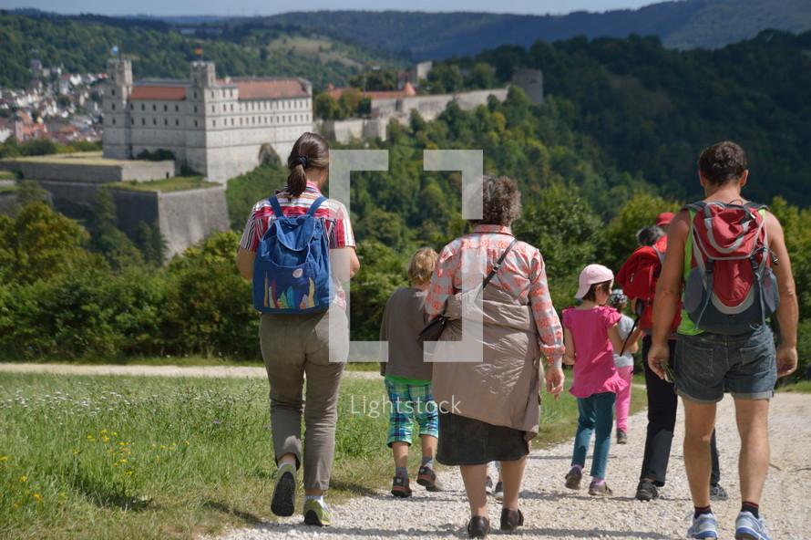 families walking down a path