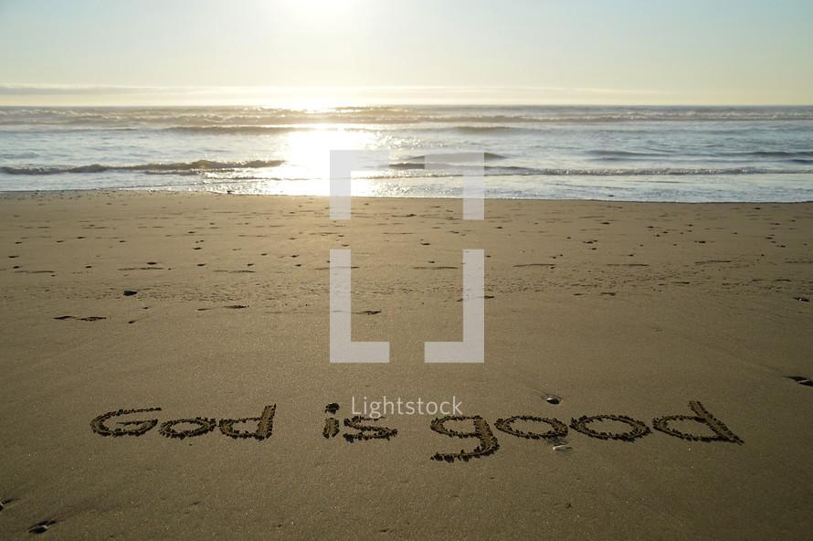 writing in the sand: God is good.  writing, sand, beach, ocean, script, write, read, reading, text, statement, testimony, declaration, message, predicate, predication, joy, pleasure, delight, gladness, glad, rejoicing, rejoice, gratefully, grateful, thankful, thankfully, thankfulness, gratefulness, gratitude, appreciation, amaze, astonishment, astonish, amazing, amazement, wonder, wonderful, stunned, letter, good, creation, beautiful, awe, awesome, summer, summertime