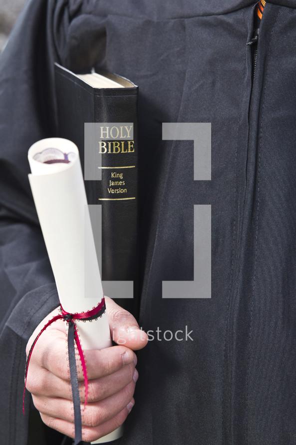graduates hand holding a diploma