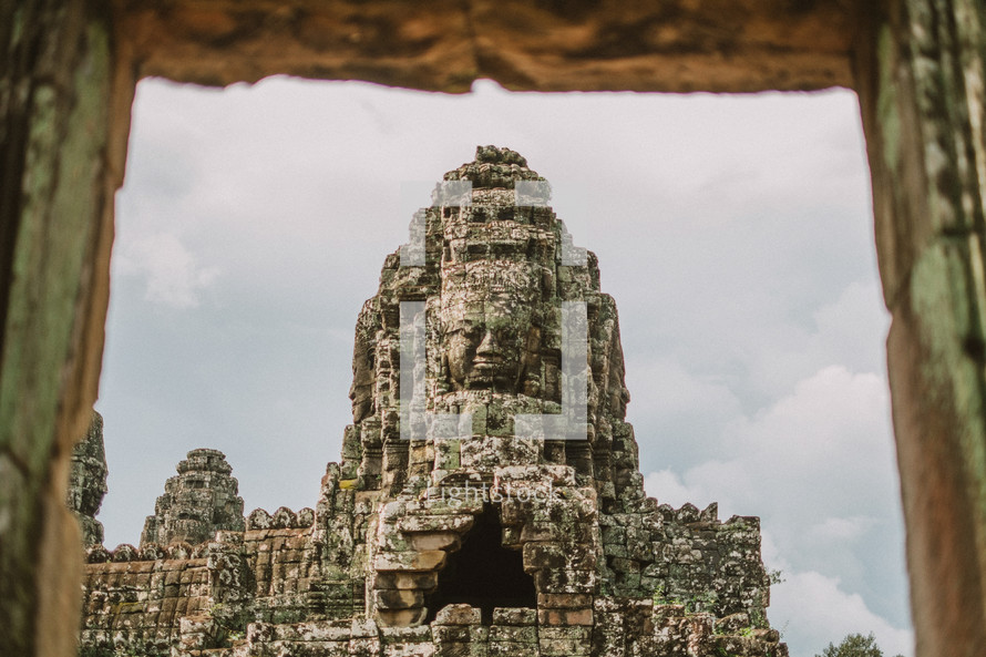 face carved in stone in temple ruins in Cambodia.