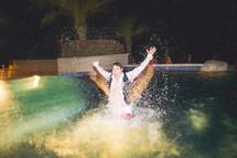groomsmen in a tuxedo splashing in a pool