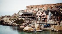 houses built into cliffs along a shore