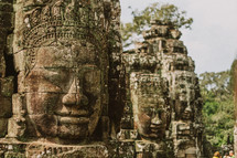 Face carved in stone in temples in Cambodia.