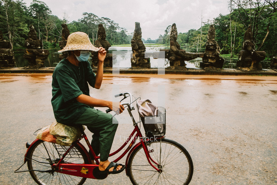 A man riding a bike in Cambodia