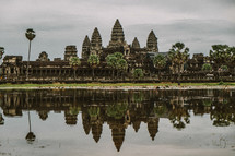 temple ruins across the water in Cambodia
