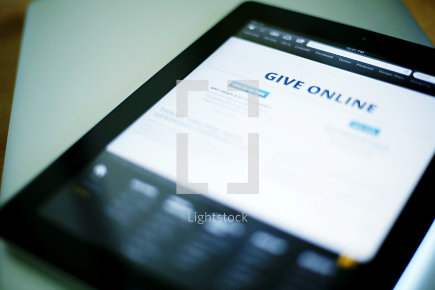 Smartphone with message encouraging giving online.
