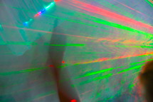 Streaks of laser light through a smokey room