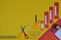 office supplies on red and yellow