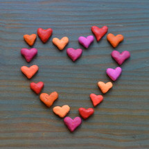 heart shaped clay on teal board