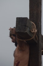 The suffering of Christ -- Jesus dying on the cross.