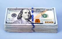 A stack of hundred dollar bills