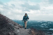 a man hiking up a mountain