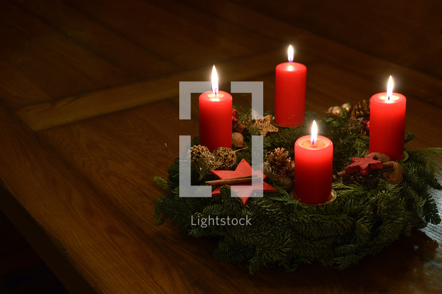 advent wreath - All four candles are burning at the Advent wreath for the fourth advent.