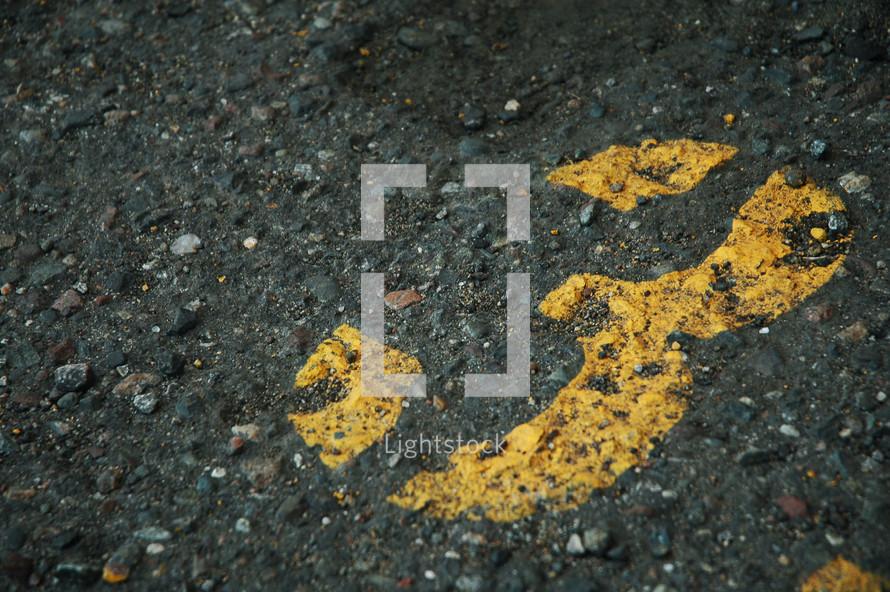 Number 3 stenciled on blacktop road.