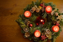 Five candles are burning at the Advent wreath for christmas day