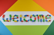 welcome - word welcome of colorful toy wooden blocks on colorful background