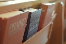 hymnals and Bibles in the back of church pews