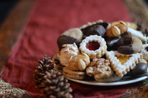 christmas cookies on a plate with christmas decoration.
