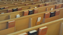 Bibles and hymnals in the back of pews